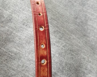 """This is a burgundy bracelet and fits a 6 1/2"""" wrist."""