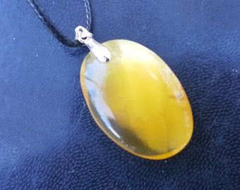 Pendant from natural baltic amber stone