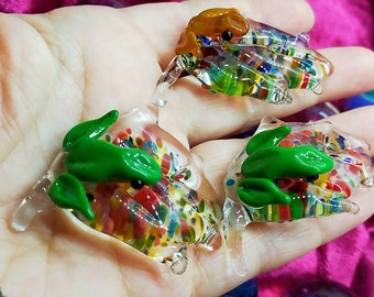 Glass frog on a leaf. Made with borosilicate glass, has beautiful multi colours in the leaf.
