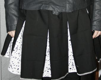 2bec4df76c Black and white piano music note pleated skirt