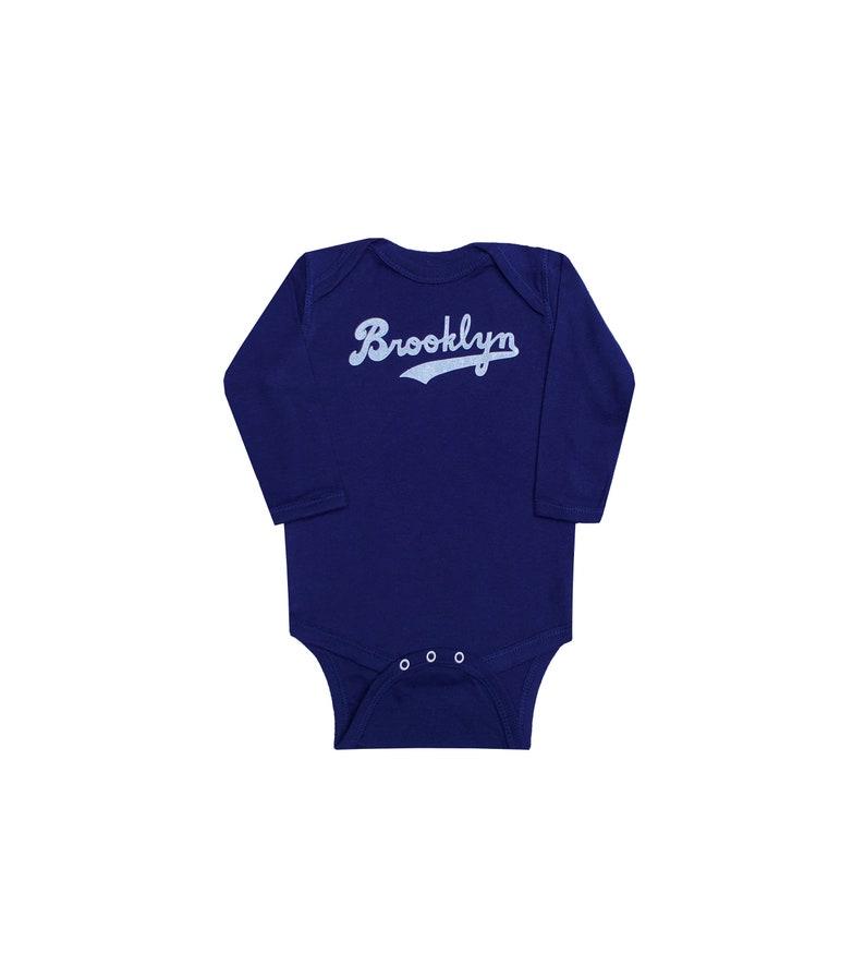 Brooklyn Baby Navy Long Sleeves Bodysuit.