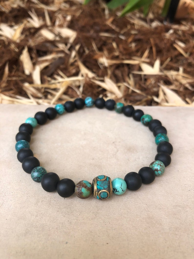 Beautiful Turquoise and Black Matte bead anklet.
