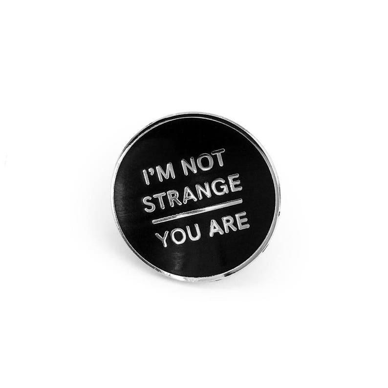 I'm Not Strange Enamel Pin image 0
