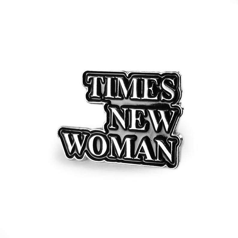 Times New Woman Silver Enamel Pin image 0