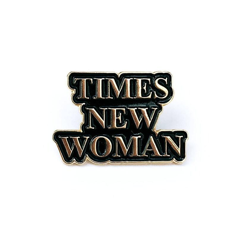 Times New Woman Gold Enamel Pin image 0