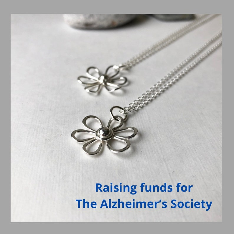 Charity silver open flower  necklace sterling silver image 0