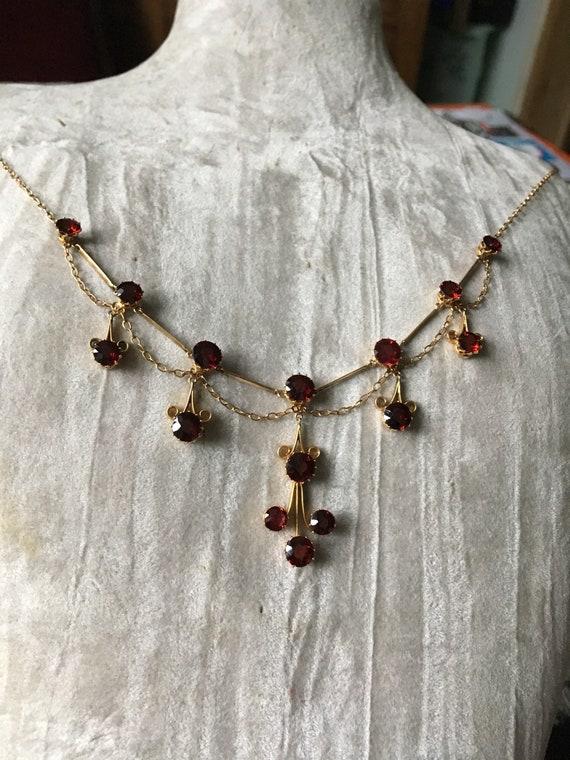 Edwardian 9ct gold garnet necklace.