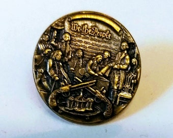 """Vintage """"We The People""""  lapel pin."""