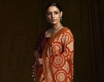 1c4e6cd21a Handwoven Banarasi Georgette Saree in Orange with Meenakari from Weaverstory