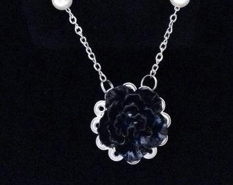Women with unique shaped flower pendant necklace