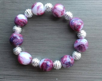 Unique handmade bracelet with polymer clay - shaped beads