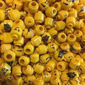 Authentic 25 qty LEGO minifigure heads used excellent condition yellow
