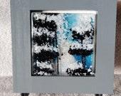 Glass desktop art, glass wall hanging, blue glass, tree art, snowy art, nature art, fused glass art, framed glass art, winter scene art