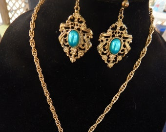 1930's Vintage tassel lariat necklace with coordinating gold tone earrings and brass cuff.