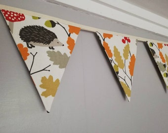 Hedgehogs, acorns and oak leaves Fabric Bunting, on a cream background. 10 flags, approx 2.5 metres
