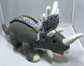 Knitted triceratops soft toy