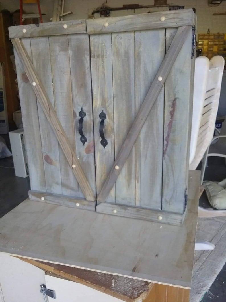 Rustic Dart Board Cabinet.