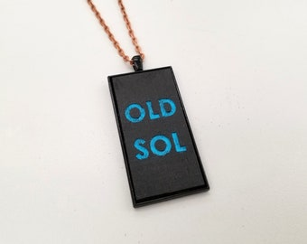 Old Sol Pendant Necklace - Black & Blue