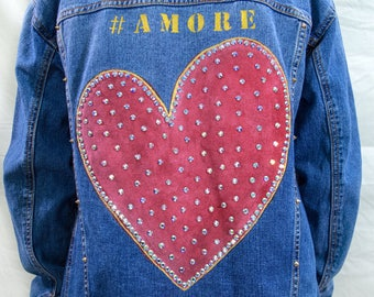 Women's one-off, unique, exclusive and bespoke 'heart' hand painted and crystal embellished denim trucker jacket in a size small