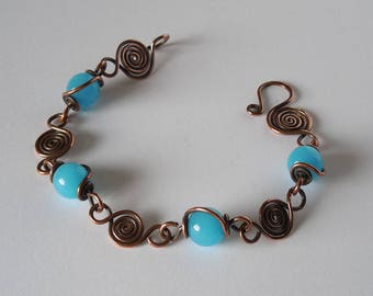 Hammered Oxidized Copper Spirals Bracelet with Sky Blue Glass Beads