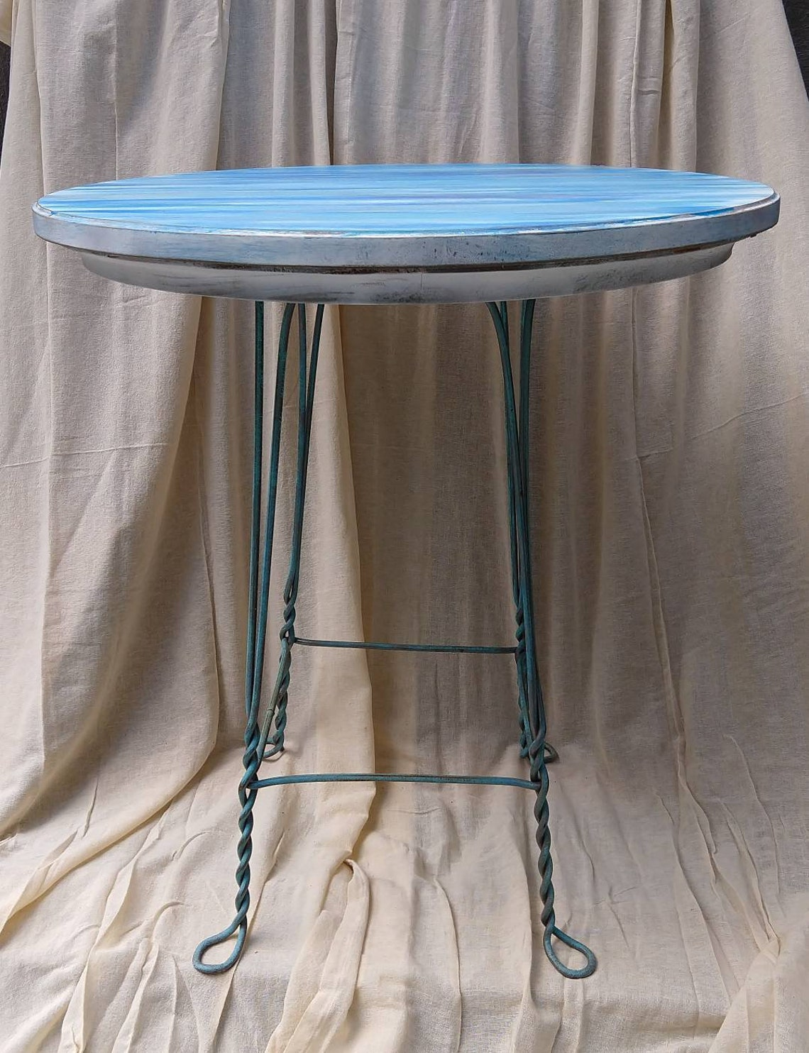 28 in round abstract painted wooden table