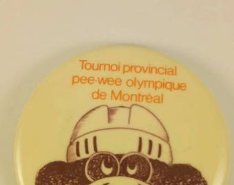 Vintage pinback button of hockey tournament in Montreal
