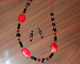 Red swirled focals with black accents