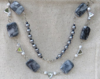Grey marble, pearls and reflective triangles