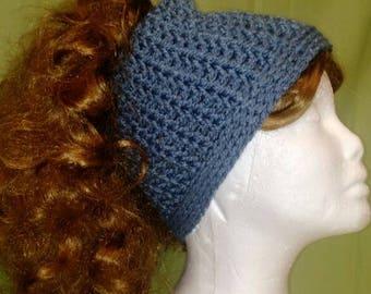 Handmade crocheted Messy Bun hat in soft blue color yarn