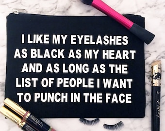 Black makeup bag/cosmetic bag • I like my lashes as black as my heart and as long as the list of people i want to punch in the face