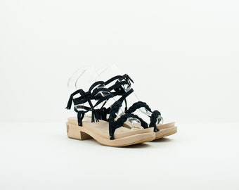 7b4961a6a Sandal. Braid in dark blue back skin. Sole in cherry wood and natural  rubber of Crepelina. Totally handmade.