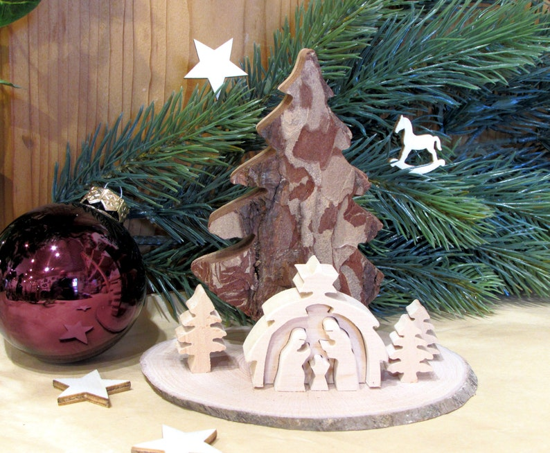 Wooden Christmas crib nativity scene on wooden disc image 0