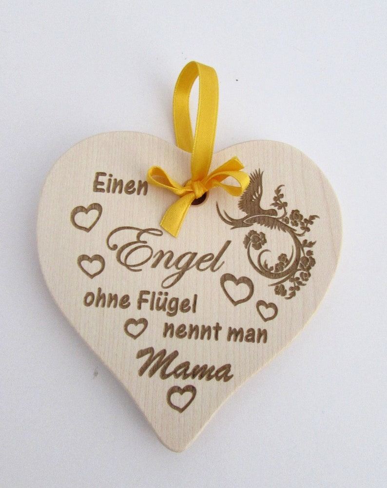 Wooden heart with engraving An angel without wings is called image 0