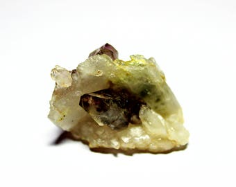 Quartz face:one side a solitaire Smoky ghosted crystal the other  side a beautiful parallel Amethyst growth w/a small scepter on left side.