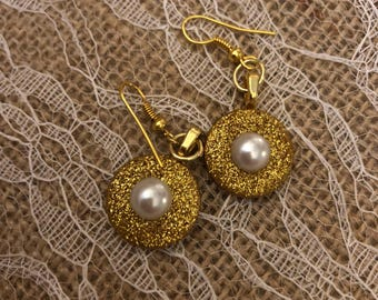 Gold button earrings with pearl accents