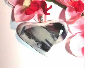 "A glass pendant fused glass ""bella"" in different colors, white, purple, pink, silver."