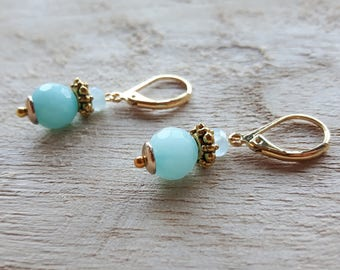 Earrings with half gem and golden accents.