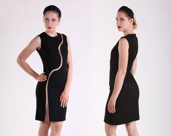Little black sheath dress with S-shaped see-through cut.