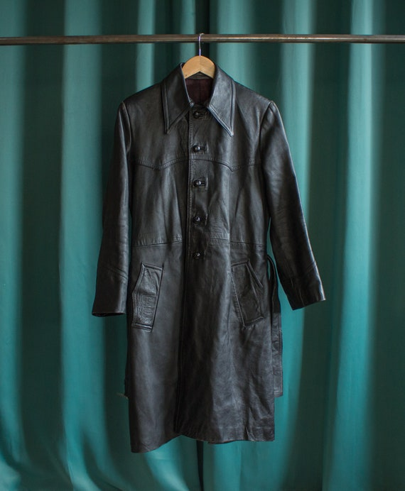 Vintage black leather trench coat with a big 70's