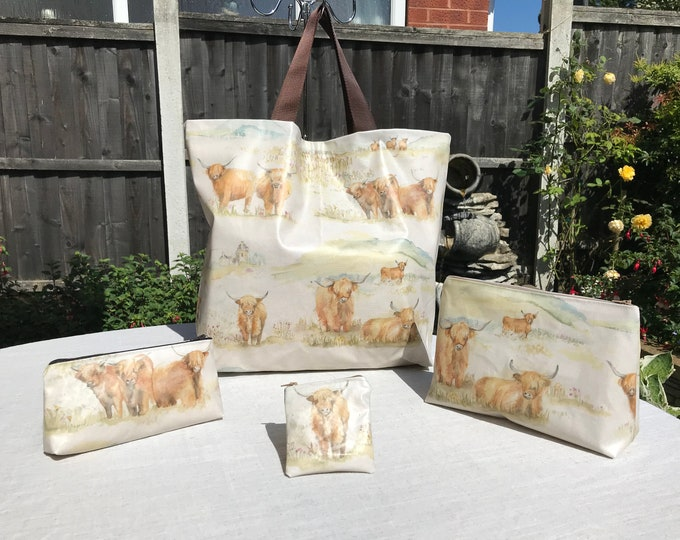 Highland Cow design bags and pouches collection in easy to wipe clean PVC