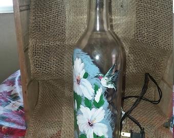 Lighted wine bottle with hummingbird
