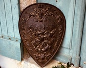 An 18th Century French hand cast iron plaque - coat of arms depicting horses, cherubs and angels - chateau wall sign