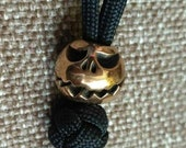 Jack O Lantern-Paracord Knife Lanyard Bead in Bronze.