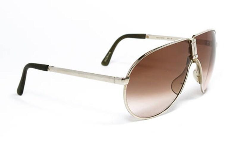57bdf4efcff59 Vintage sunglasses Porsche 5622 Folding Gold original made in