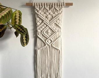 Modern macrame wall hanging in ivory