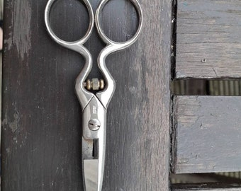 Vintage buttonhole scissors. Adjustable scissors. A must have for any seamstress, or sewing collection. Silver tone metal. Made in Italy.