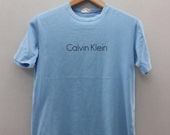 673503673bc40 Vintage Calvin Klein T shirt Designer Spellout Logo Urban Fashion Top Tees  Shirt Size M