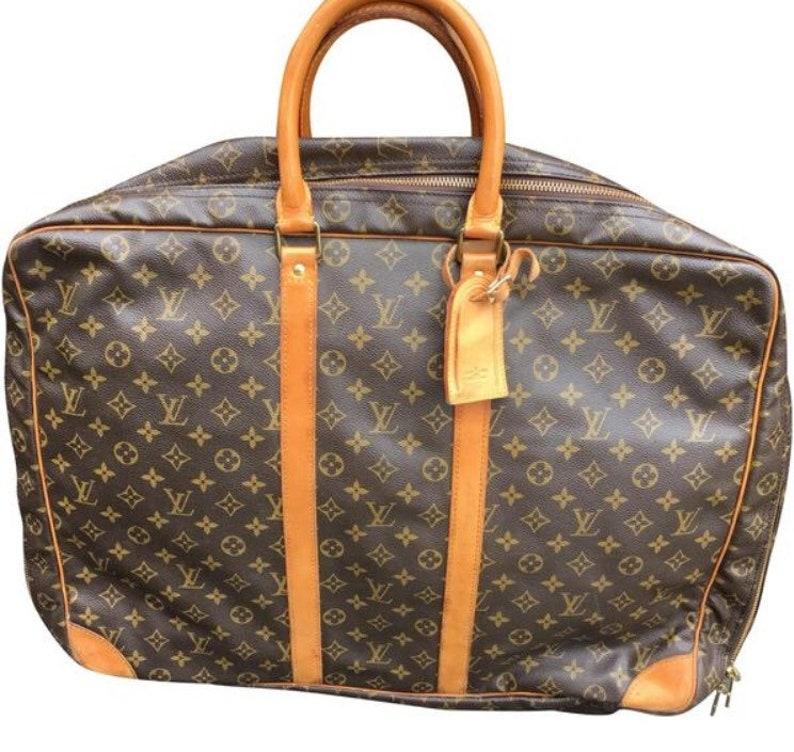 6c88648a5ccdf Vintage Louis Vuitton Sirius 55 cm Leather Weekend Bag | Etsy