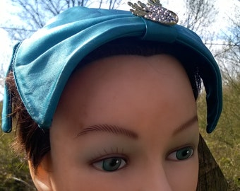1950s eggshell half hat by Jacoll in turquoise satin