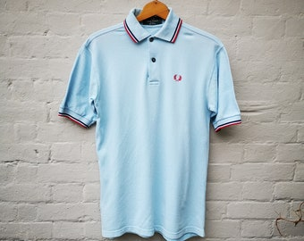 ec03b23b2 Vintage Fred Perry polo shirt, pale blue pique with red and navy stripe,  1980s made in England, size UK men's S-M